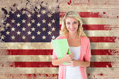 Student smiling against usa flag — Stock Photo
