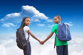 Pupils holding hands against  sky — Stock Photo