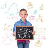 Cute pupil showing chalkboard — Stock Photo