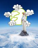 Thinking businessman against mountain peak — Stock Photo
