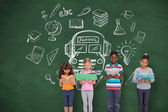 Pupils against chalkboard with school doodles — Stock Photo