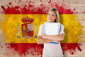 Student smiling against spain flag — Stock Photo