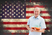 Student holding notebooks against usa flag — Stock Photo