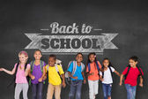 Pupils against wall with back to school message — Stock Photo