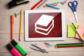 Composite image of digital tablet on students desk — Stockfoto