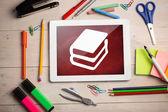Composite image of digital tablet on students desk — Stock fotografie