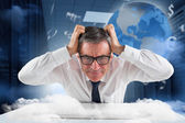 Stressed businessman using a keyboard — Stock Photo