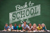 Pupils with teacher against back to school message — Stock Photo