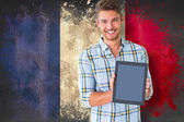 Student showing tablet against france flag — Stock Photo
