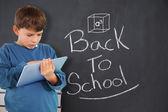 Boy using tablet against back to school message — Foto de Stock