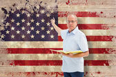 Teacher holding book against usa flag — Stock Photo
