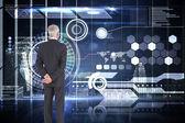 Businessman against hologram interface — Stock Photo