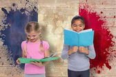 Pupils reading against france flag — Stock Photo