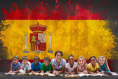 Pupils with teacher against spain flag — Stock Photo