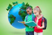 Pupils reading against vignette with globe — Stock Photo