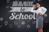 Focused businesswoman against blackboard — Stock Photo