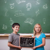 Pupils showing chalkboard — Stock Photo