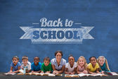 Pupils with teacher against with back to school message — Stock Photo