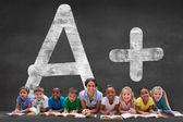 Pupils with teacher against plus grade — Stock Photo