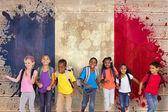 Pupils running against france flag — Stock Photo