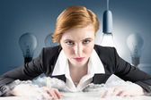 Businesswoman sitting at desk typing — Stock Photo