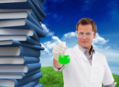 Scientist working with beaker — Stock Photo