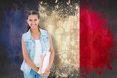Student holding notepads against france flag — Stock Photo