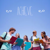 Word achieve against students — Stock Photo