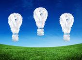 Composite image of cloud light bulbs — Stock Photo