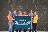 Group of people holding blackboard — Stock Photo