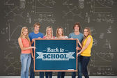Group of people holding blackboard — Stock Photo