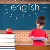 English against red apple on pile of books in classroom — Stock Photo