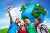 Pupils taking a selfie against green hill — Stock Photo