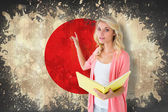 Student pointing against japan flag — Stock Photo