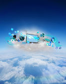 Laptop on floating cloud with apps — Stockfoto