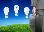 Businessman holding briefcase — Stock Photo
