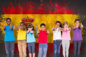 Elementary pupils against spain flag — Stock Photo