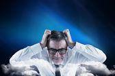 Businessman touching his head — Stockfoto