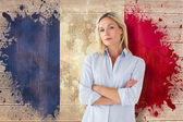 Student frowning against france flag — Stockfoto