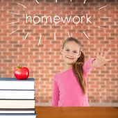 Homework against red apple on pile of books — Stock Photo