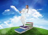 Woman carrying pile of books — Stock Photo