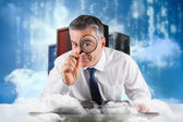 Businessman examining with magnifying glass — Photo