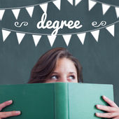 Degree against student holding book — Stock Photo