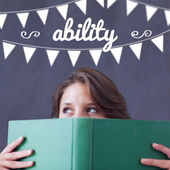 Ability against student holding book — Stock Photo