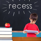 Recess against red apple on pile of books in classroom — Stock Photo