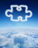 Cloud in shape of jigsaw piece — Стоковое фото