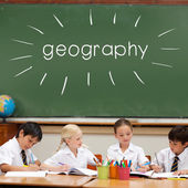 Word geography against cute pupils — Stock Photo