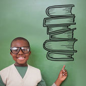 Pupil pointing against stack of books — Foto de Stock