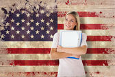 Student smiling against usa flag — Stock Photo