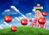 Student holding an apple and books — Stock Photo